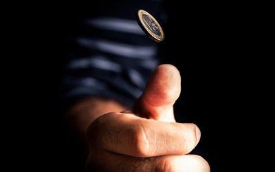 кинути монетку